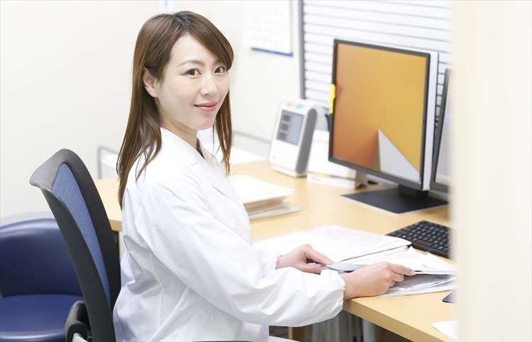 Image of a female doctor in a white coat