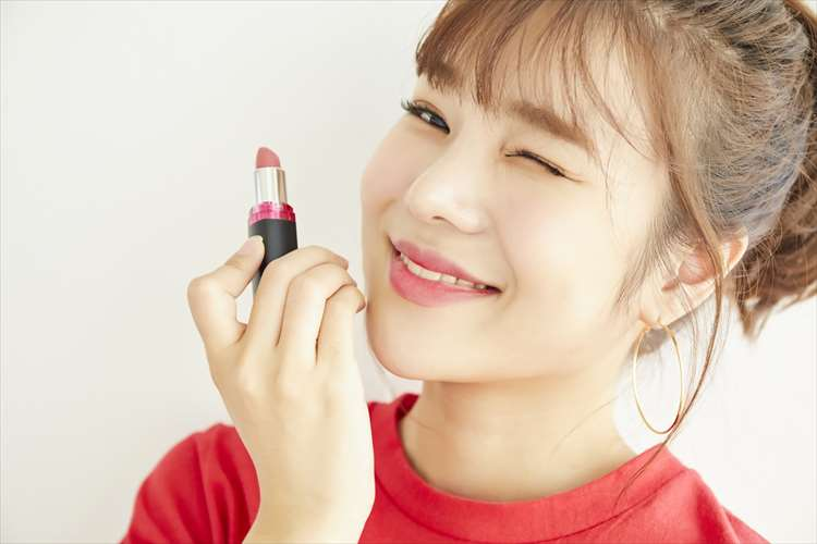 Image of a woman winking with lipstick